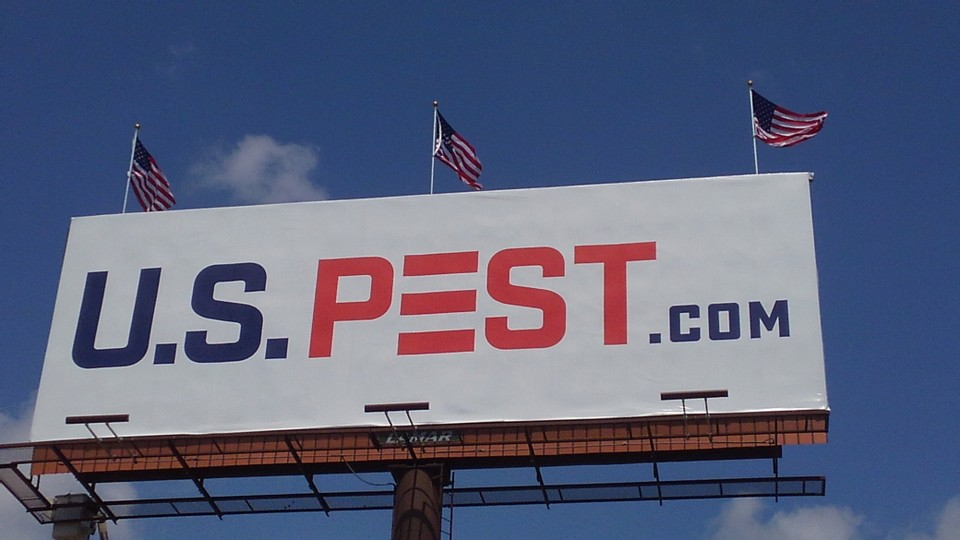U.S. Pest Protection displays bold billboards with American flags surrounding Nashville